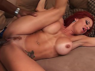 Redhead Babe With Big Tits Gets Her Asshole Fucked By A Black Cock
