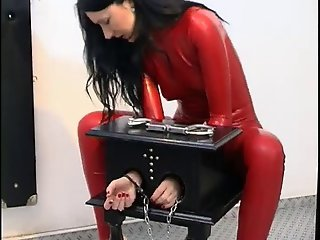 German Slut In Red Latex Enjoys Some Kinky Self Bondage