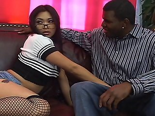 Asian Babe Mika Tan Stuffs Her Mouth With A Big Black Cock