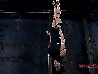 Slave Girl Hanging By His Feet From The Ceiling
