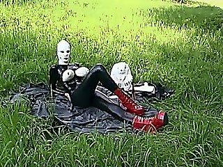 German Babe In Black Latex And Mask Has A Bizarre Outdoor Picnic