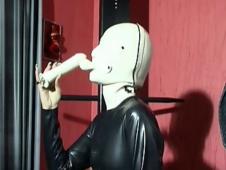 German Babe In A Gimp Outfit With A Hose Attached To Her Mask
