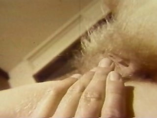 Blonde Fingers Her Hairy Pussy In Vintage Porn Scene