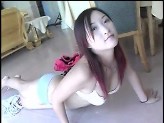 pretty chinese babe pampering her pussy