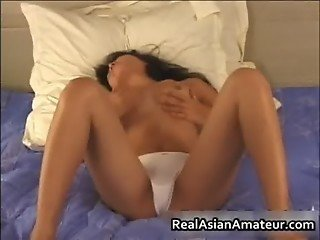 Asian nympho wets her panties on a solo