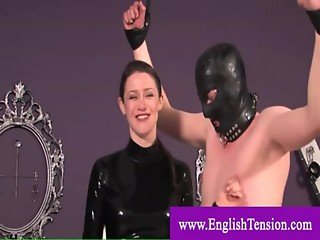 Domina dominating man with cock cage