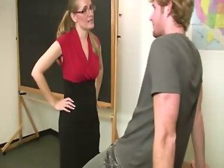 Sexy MILF teacher with glasses samples her students cock