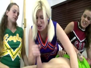 Horny cheerleader tugs for a crowd