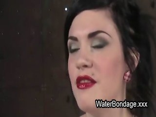 Gagged brunette gets water bondage
