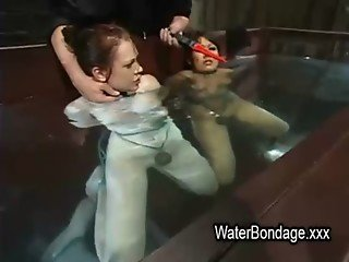 Two bound lesbians submerge in water
