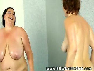 Huge brunette BBW wrestling smaller brunette BBW in arena