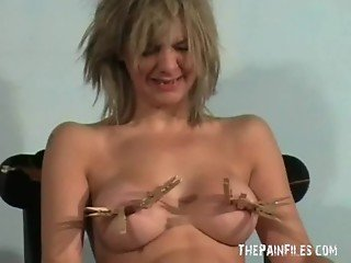 Trashy milf in amateur bdsm and pegged tit torture of Emma