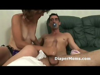 Caring mommy gives crying adultbaby blowjob to make him got to sleep