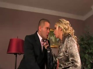 Horny clothed blonde gets a mouthful