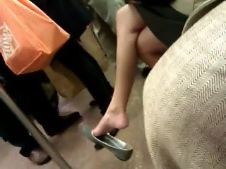 Asian milf expert dangle in flats on F train