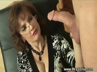 Domina uses various gloves on slaves cock