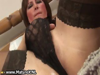 Horny old mom spreads her legs