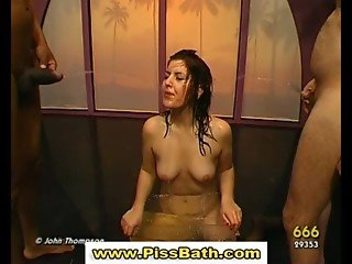 Golden shower fetish slut is drenched in piss