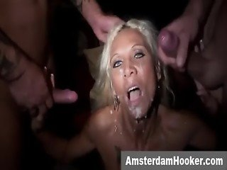 Blonde prostitute takes double facial