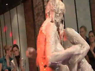 Topless mud wrestlers show messy tits