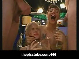 Two kinky babes drinking piss from four guys