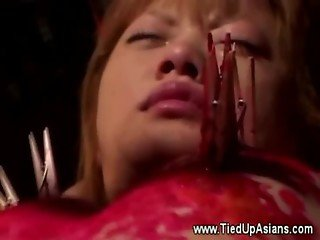Submissive asian getting hot wax over her body