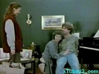 Threesome with piano teacher and students