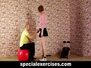 Dominant trainer and submissive young lady