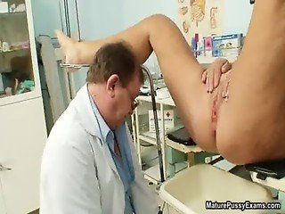 Horny old doctor injects a speculum