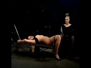 Dominatrix puts clamps on an asians pussy