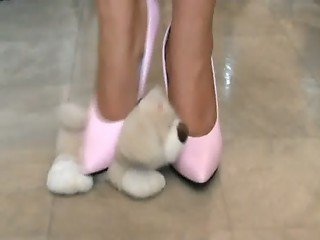 Pink high heels teddy bear crushing