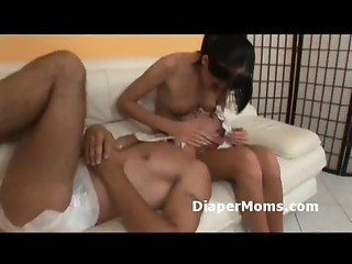 Skinny brunette breast feeds her diaper wearing boy and checks his smelly diaper