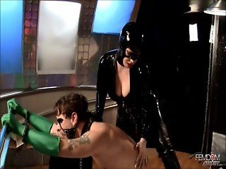 Catwoman humiliating her sworn enemy