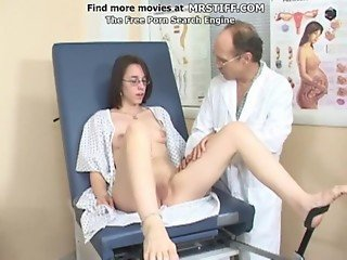 A girl with glasses at the doctor