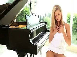 Sweet blonde beauty finger screwing her pink pussy beside the piano