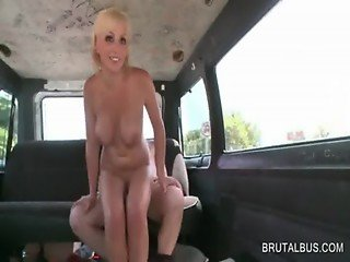 Blonde seductress gives BJ in the bus
