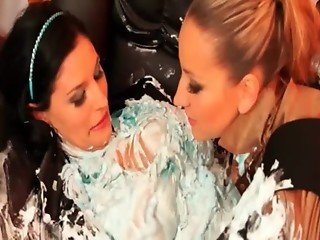 Hot lesbos covered in messy cream making out