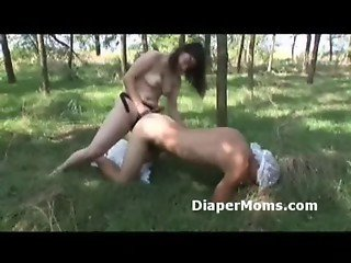 Diaper wearing adult baby assfucked by moms strapon outdoors