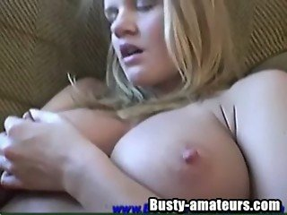 Busty Lisa fingering her pussy on couch