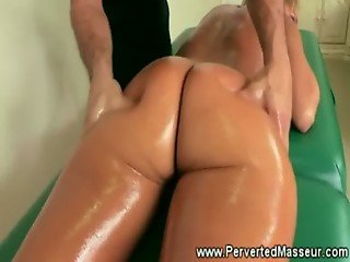 Tanned pornstar gets hot massage and her ass pulled apart