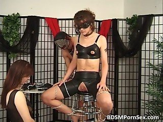 Odd BDSM action with two brunettes who