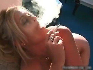 Blond MILF with huge juggs doing