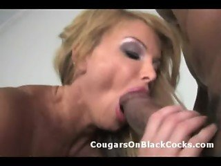 Mature MILF stuffs her experienced pussy with huge black cock