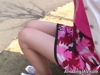 Cute asian schoolgirl flashing her