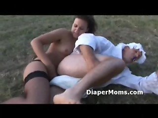 Adult in baby clothes gets his ass fucked by mommys strapon