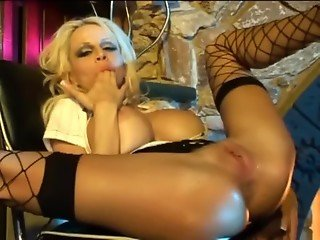 Busty blonde milf does anal in fishnet stockings