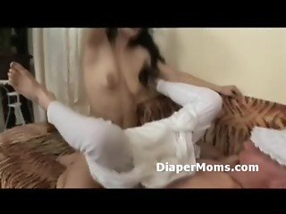 Caring mommy strap-on fucks her adult baby while she jerks his dick