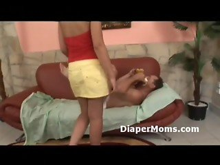 Young mommy breastfeeds adult baby then bends him over and strap-on fucks him