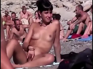 Scratching pussy on beach - Nudist beach
