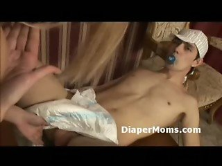 Woman breastfeeds adult wearing diaper and penetrates his fuck hole with strapon